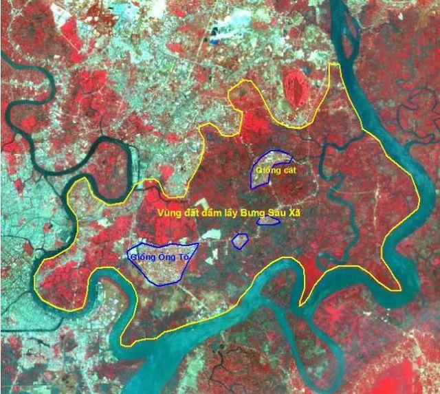 Hình 1. Ảnh Landsat TM năm 1992. Vùng đất thấp (đầm lầy) có màu đỏ và nâu thẫm